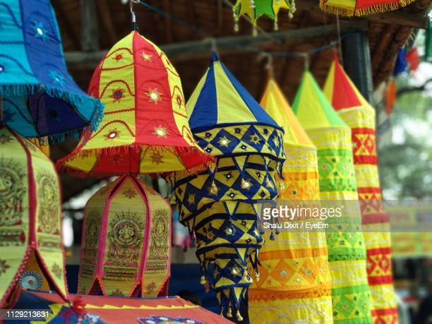 close-up of multi colored lanterns hanging for sale at market - haryana stock photos and pictures