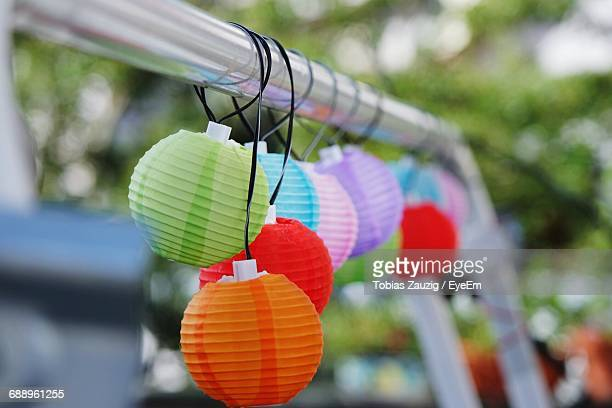 close-up of multi colored lighting decoration hanging from metal rod - erlangen stock photos and pictures