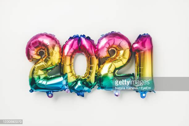 close-up of multi colored number over white background - 2021 stock pictures, royalty-free photos & images