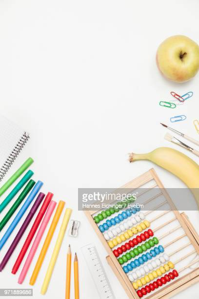 close-up of multi colored objects on white background - abaco imagens e fotografias de stock