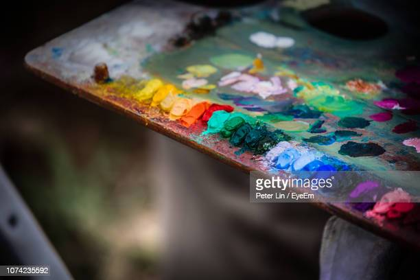 close-up of multi colored paints on palette - artist's palette stock photos and pictures
