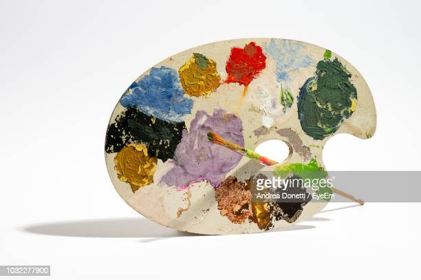 close-up of multi colored palette against white background - art and craft equipment stock pictures, royalty-free photos & images