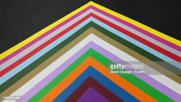 close-up of multi colored papers - triangle shape stock pictures, royalty-free photos & images