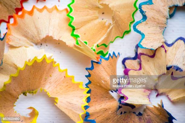 Close-Up Of Multi Colored Pencil Shavings On Table