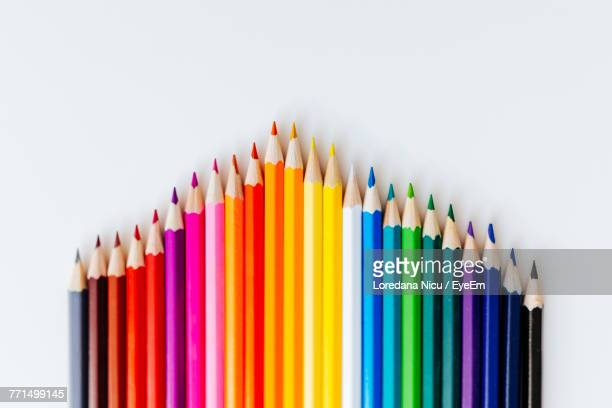 close-up of multi colored pencils against white background - color pencil stock pictures, royalty-free photos & images