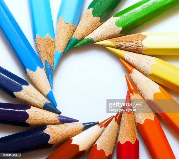 close-up of multi colored pencils arranging on white background - color pencil stock pictures, royalty-free photos & images