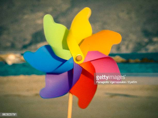 close-up of multi colored pinwheel - vgenopoulos stock pictures, royalty-free photos & images