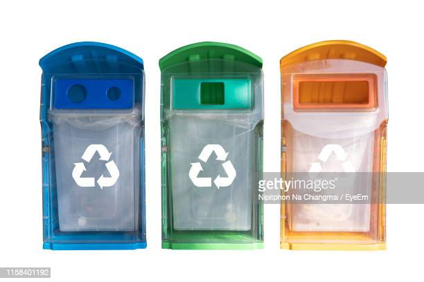 close-up of multi colored recycling bins on white background - recycling bin stock pictures, royalty-free photos & images