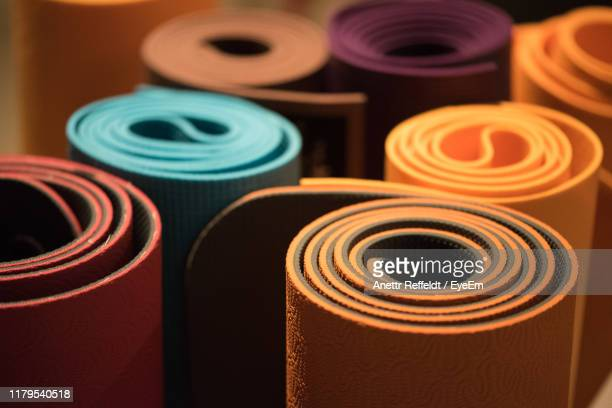 close-up of multi colored rolled exercise mats - エクササイズマット ストックフォトと画像