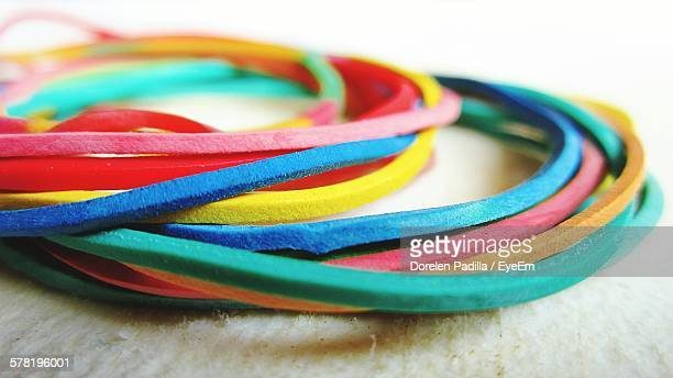 Close-Up Of Multi Colored Rubber Bands On Table