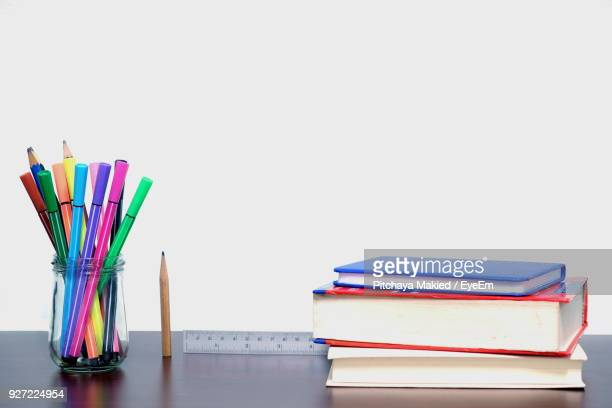 Close-Up Of Multi Colored School Supplies On Table