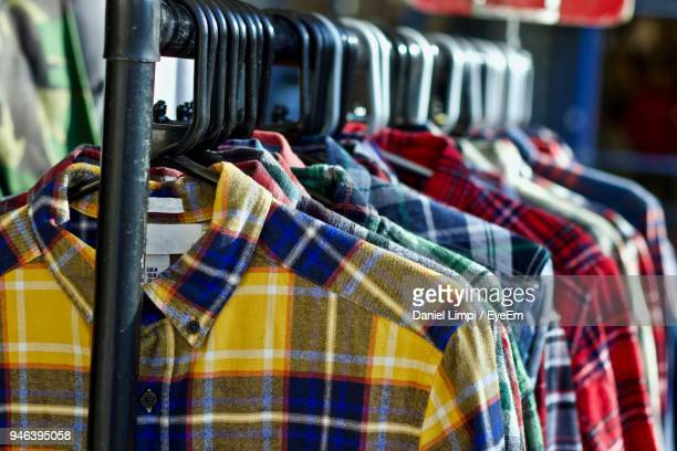close-up of multi colored shirts for sale in store - plaid shirt stock pictures, royalty-free photos & images