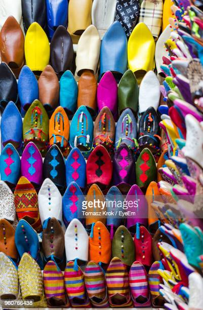 Close-Up Of Multi Colored Shoes For Sale In Market