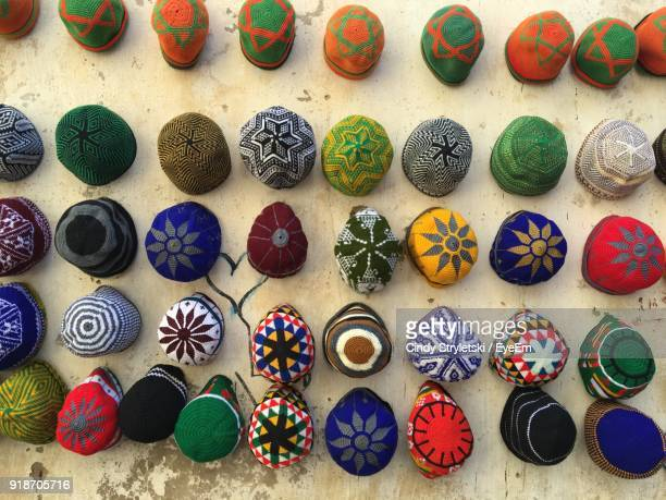 Close-Up Of Multi Colored Skull Caps Hanging On Wall For Sale