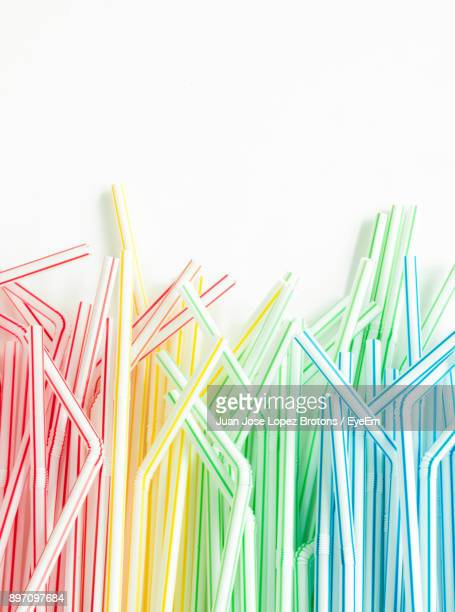 close-up of multi colored straws over white background - drinking straw stock pictures, royalty-free photos & images