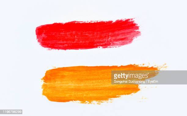 close-up of multi colored strokes over white background - brush stroke stock pictures, royalty-free photos & images