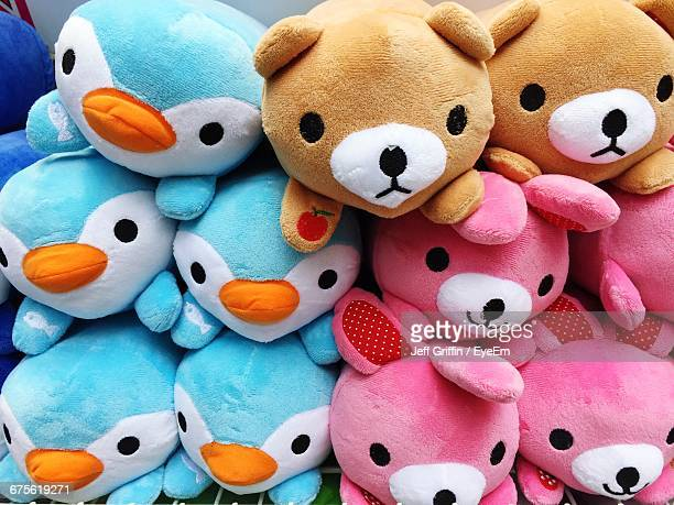 Close-Up Of Multi Colored Stuffed Toys For Sale In Shop