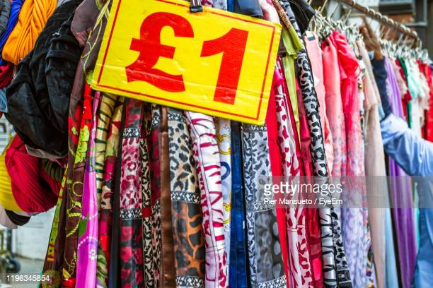 close-up of multi colored textiles hanging for sale in store - number 1 stock pictures, royalty-free photos & images
