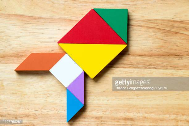 close-up of multi colored toy blocks on table - building blocks stock pictures, royalty-free photos & images