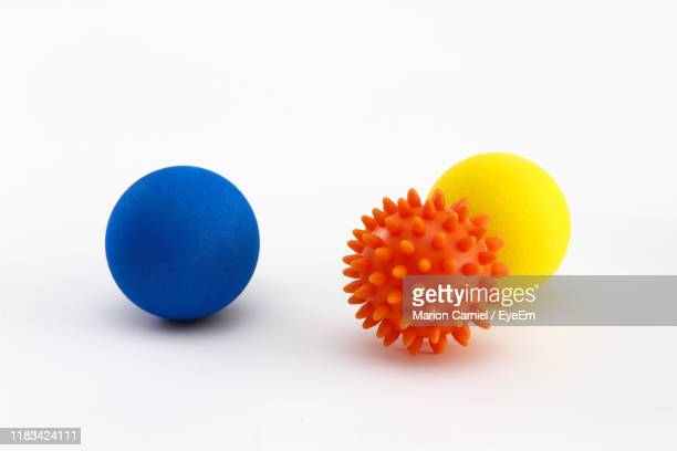 close-up of multi colored toys against white background - sports ball stock pictures, royalty-free photos & images