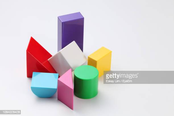 close-up of multi colored toys over white background - shape stock pictures, royalty-free photos & images