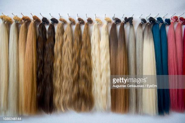 close-up of multi colored wigs hanging on rack - wig stock pictures, royalty-free photos & images