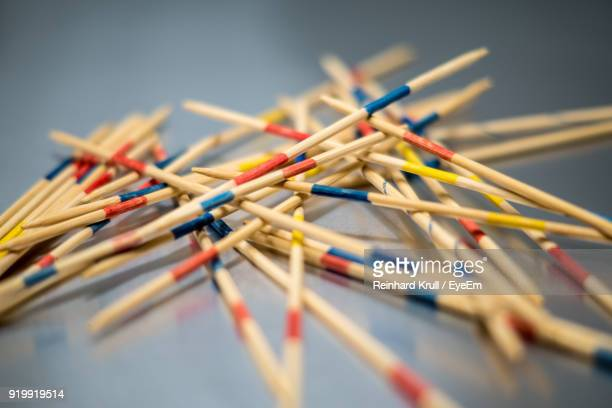 Close-Up Of Multi Colored Wooden Sticks On Table