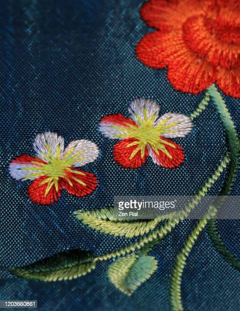 close-up of multicolor machine embroidered flowers on a purse - embroidery stock pictures, royalty-free photos & images