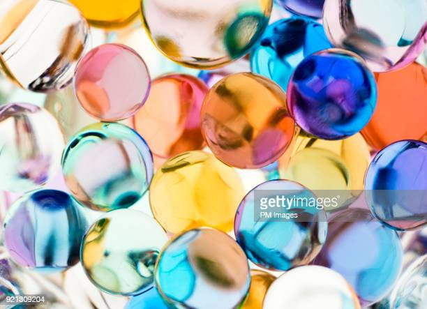 close-up of multi-colored balls - translucent stock pictures, royalty-free photos & images