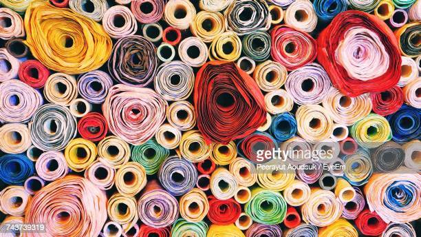 close-up of multicolored fabric for sale in store - rolled up stock pictures, royalty-free photos & images