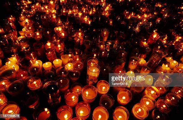 a close-up of multiple candles in a vigil - memorial event stock pictures, royalty-free photos & images