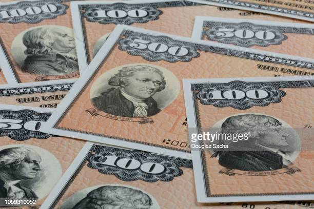 close-up of multiple savings bonds - stock certificate stock pictures, royalty-free photos & images