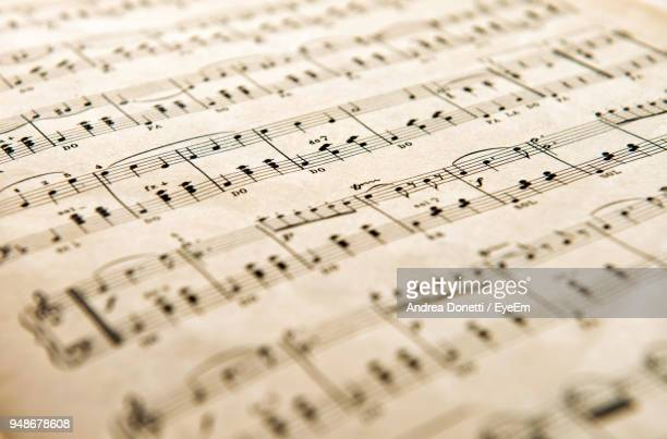 close-up of musical notes on paper - musical note stock photos and pictures