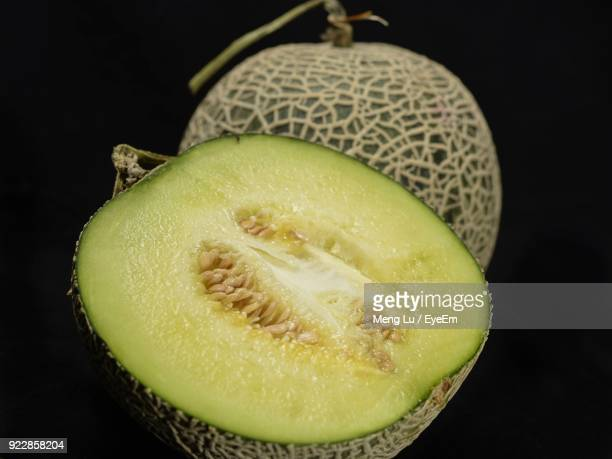 close-up of muskmelon against black background - muskmelon stock pictures, royalty-free photos & images