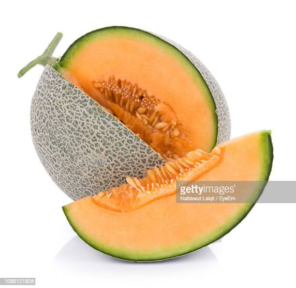 close-up of muskmelon against white background - muskmelon stock pictures, royalty-free photos & images