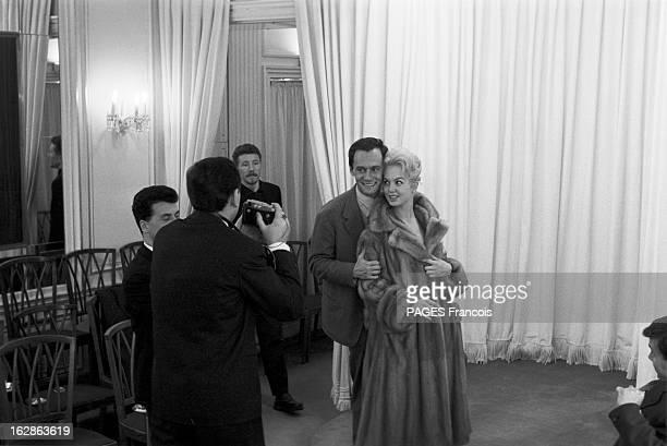 Close-Up Of Mylene Demongeot. Avril 1958. Henri COSTE pose aux côtés de son épouse Mylène DEMONGEOT habillée d'un manteau de fourrure et une...