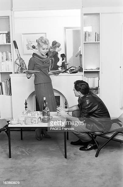 Close-Up Of Mylene Demongeot. Avril 1958. L'actrice Mylène DEMONGEOT et son mari Henri COSTE, déjeunent en tête à tête, devant la cheminée.