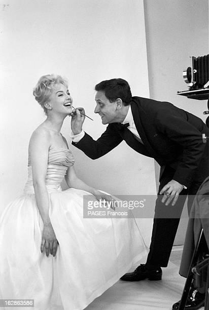 Close-Up Of Mylene Demongeot. Avril 1958. Retouche maquillage avant la séance de prise de vue pour l'actrice Mylène DEMONGEOT faite par son mari , le...