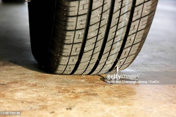 close-up of nail by tire - puncturing stock pictures, royalty-free photos & images