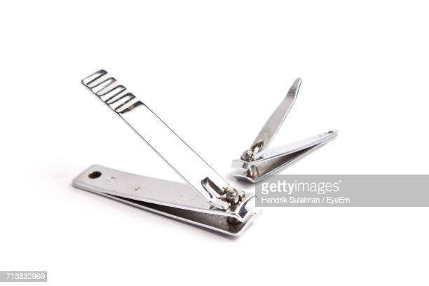 Close-Up Of Nail Clipper Against White Background