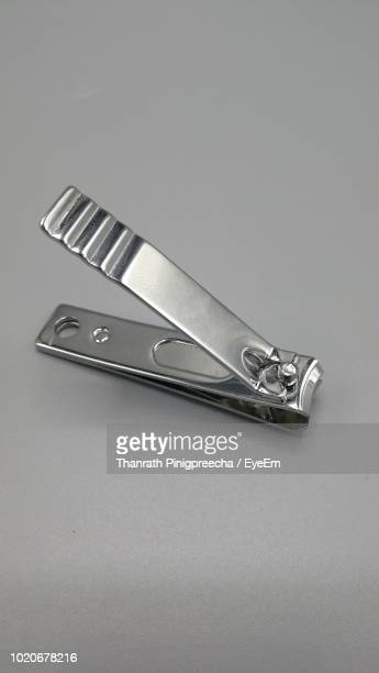 Close-Up Of Nail Clipper On Table