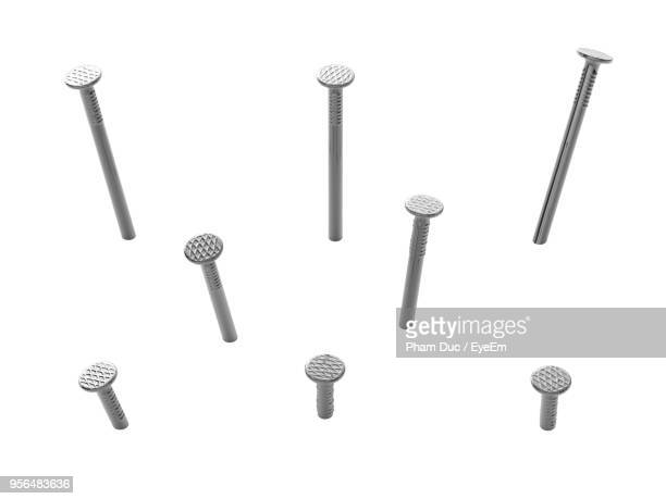 Close-Up Of Nails Against White Background