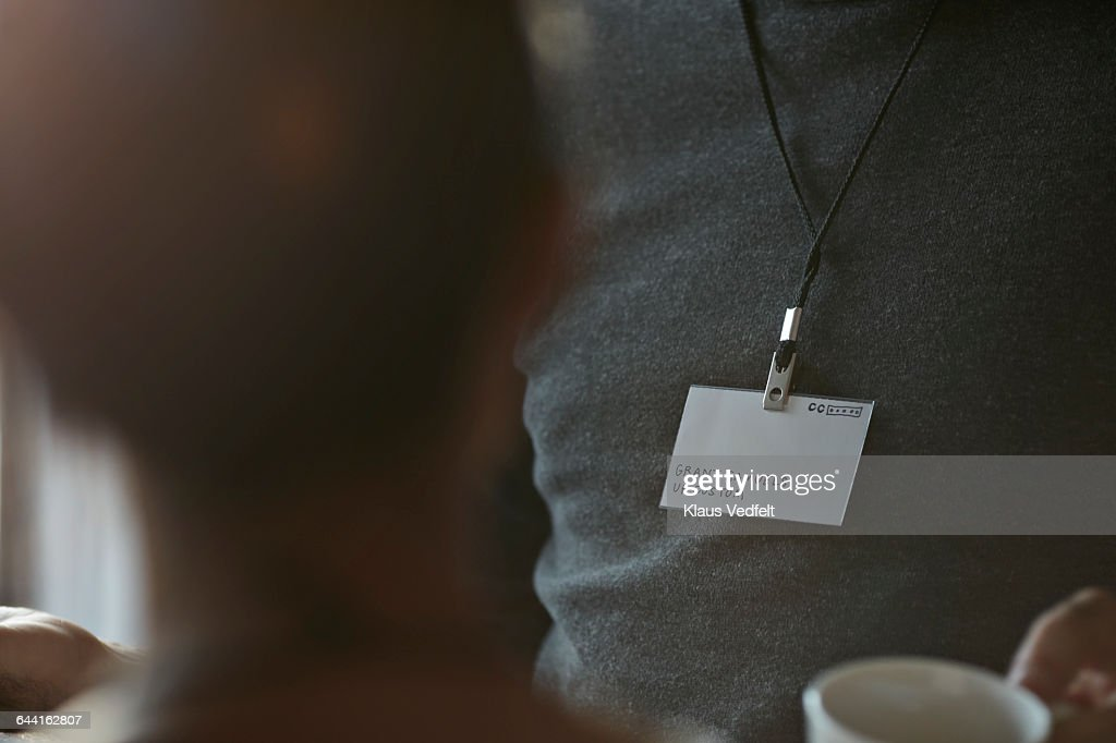 Close-up of name tag of businessman at conference : Stock Photo