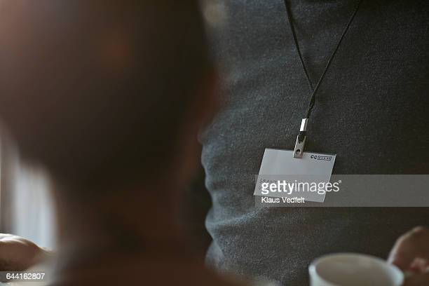 Close-up of name tag of businessman at conference