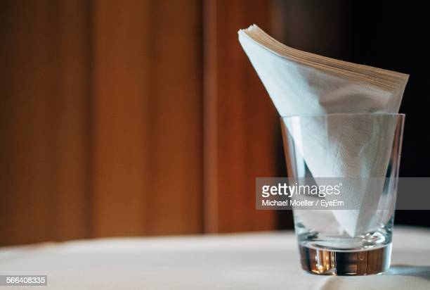 close-up of napkins in drinking glass on table - paper napkin stock photos and pictures