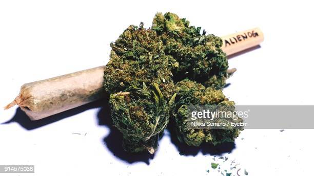 close-up of narcotics over white background - smoking weed stock photos and pictures