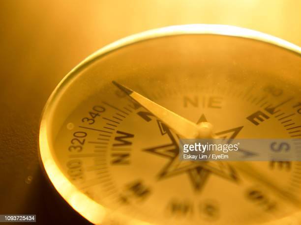 close-up of navigational compass - compass stock pictures, royalty-free photos & images