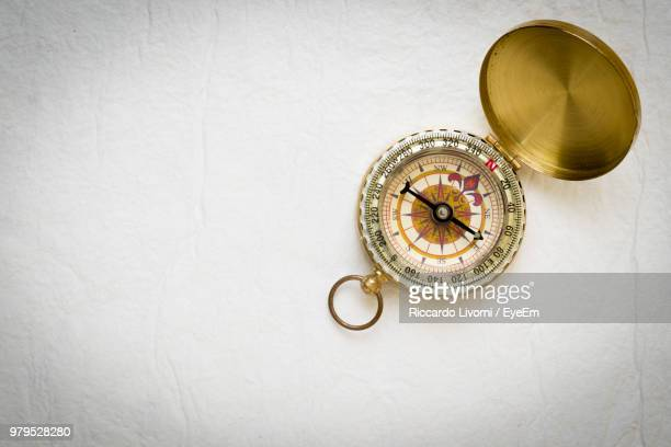 close-up of navigational compass - compass stock photos and pictures