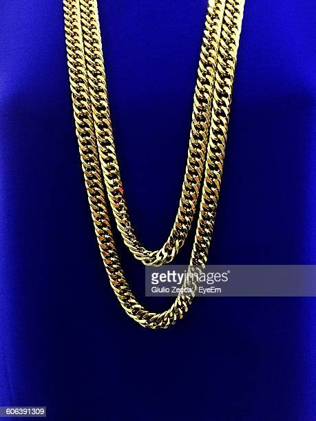 close-up of necklace against blue background - choker stock pictures, royalty-free photos & images