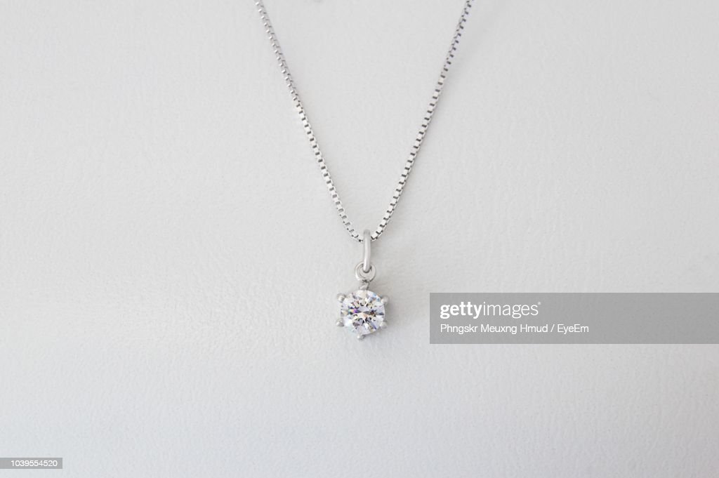 Close-Up Of Necklace Against White Background : Stock Photo